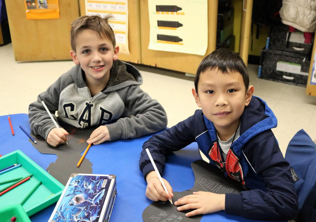 Photo of Tamaques students working on 100th Day activity.