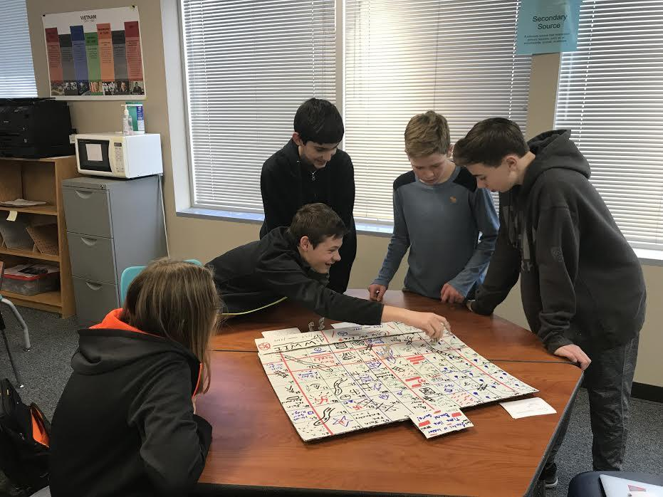 Eighth graders work together on the prototypes for their Cold War games.