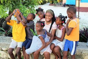 Teja Brown Haiti trip help outside