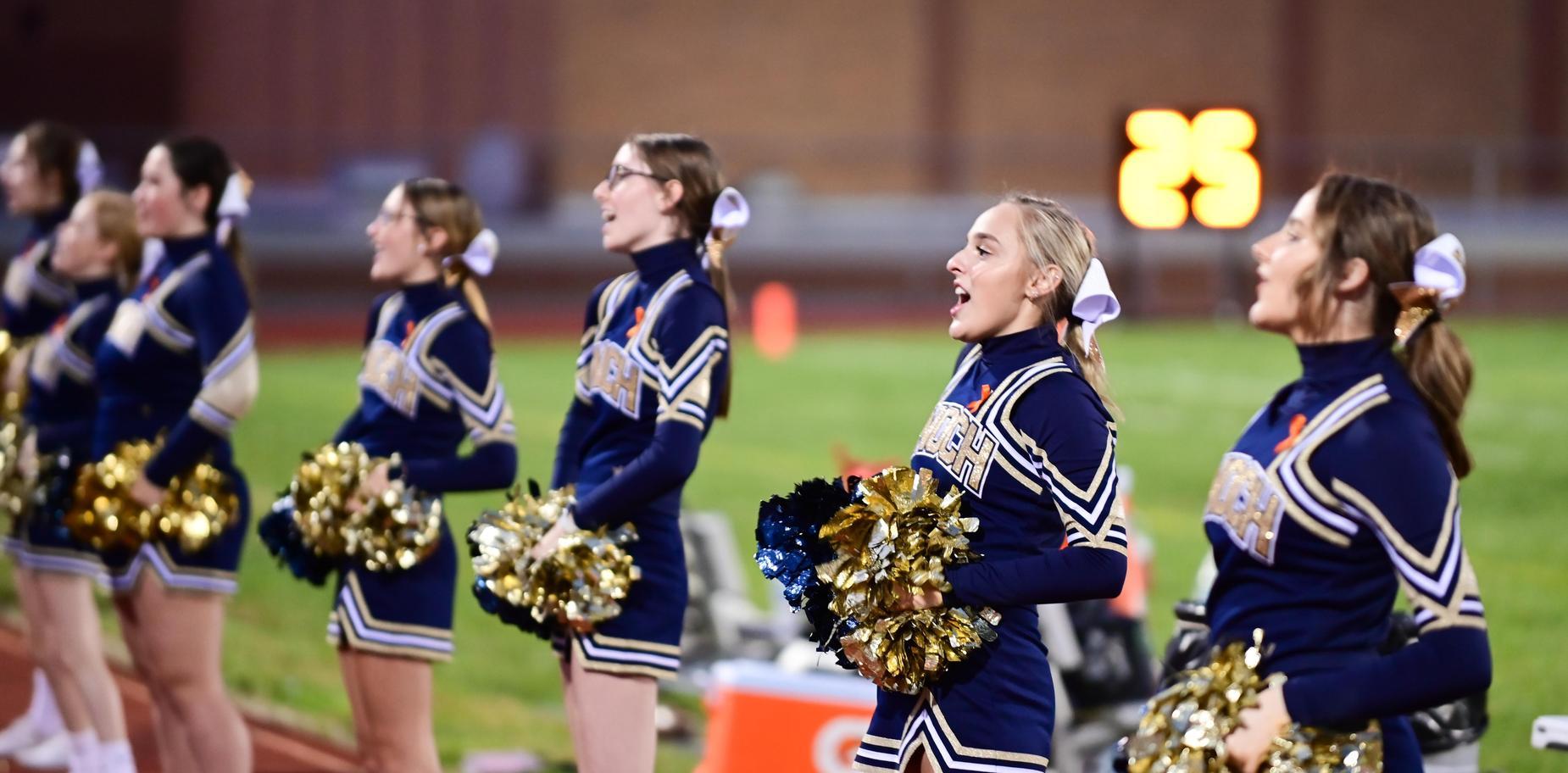 Cheerleaders on sidelines during game
