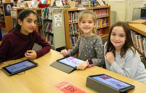 From left, Franklin School students enjoy Hour of Code activities on Dec. 4 during Computer Science Education Week.