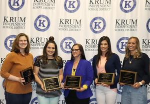 the five teachers of the year stand together with their plaques