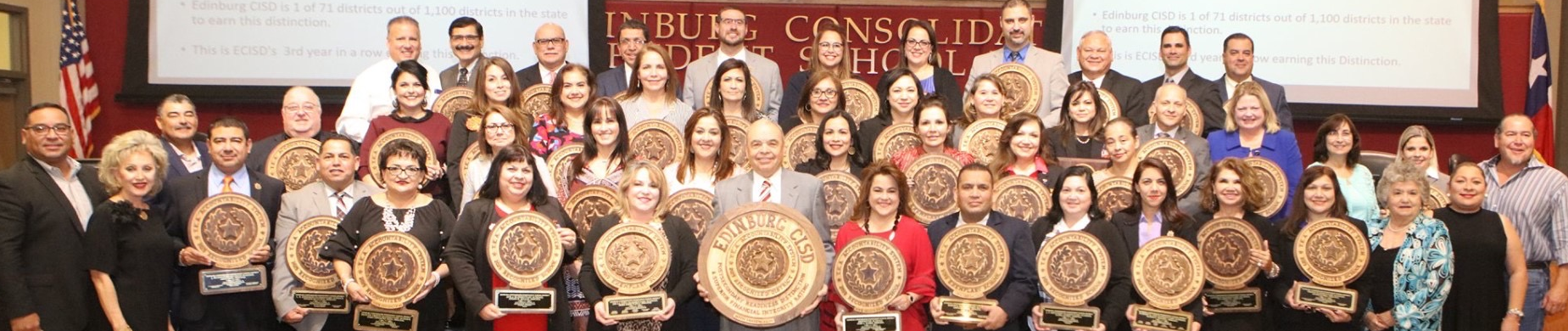 2019-2020 ECISD School board and administration hold up awards for the district.