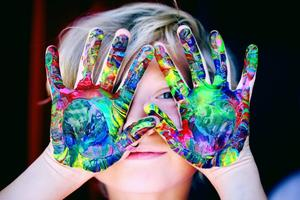 child with messy hands