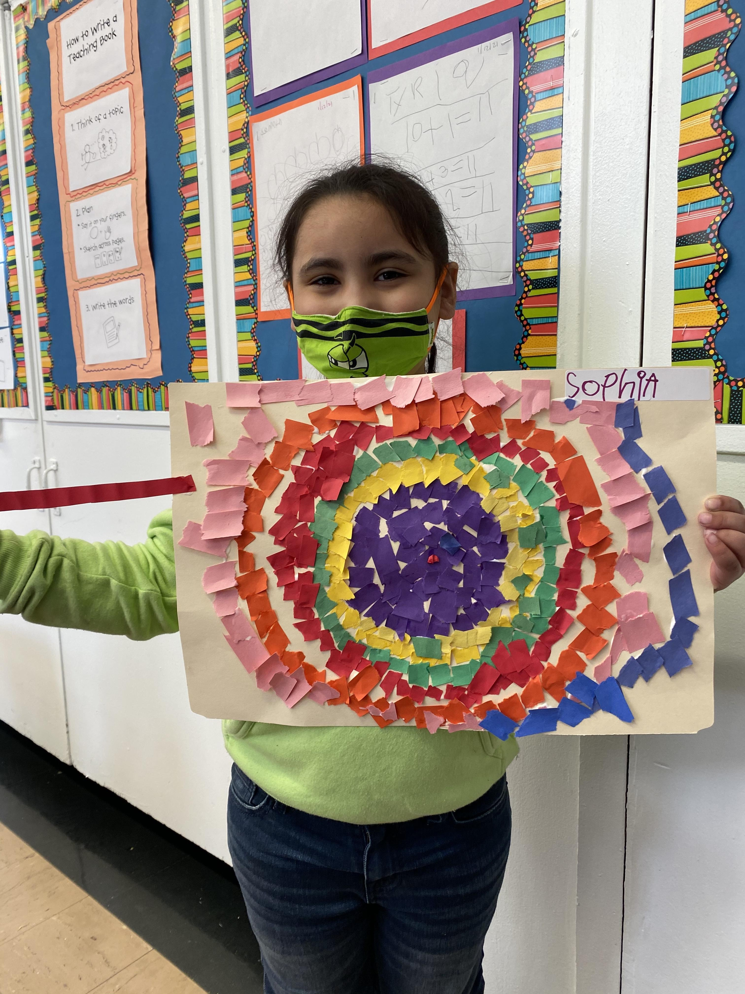 girl holding mosaic project