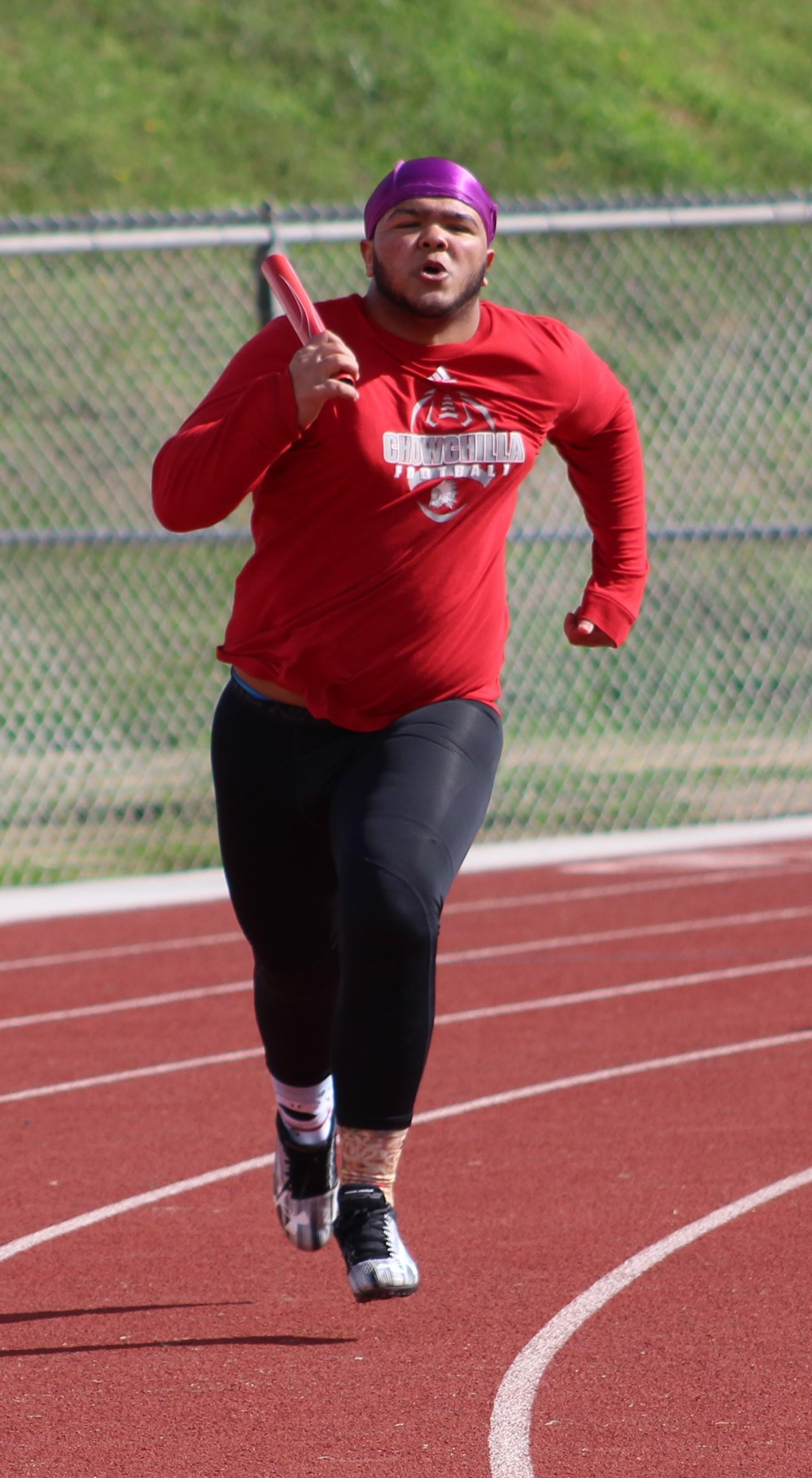 Track and Field athletes in action at Fowler