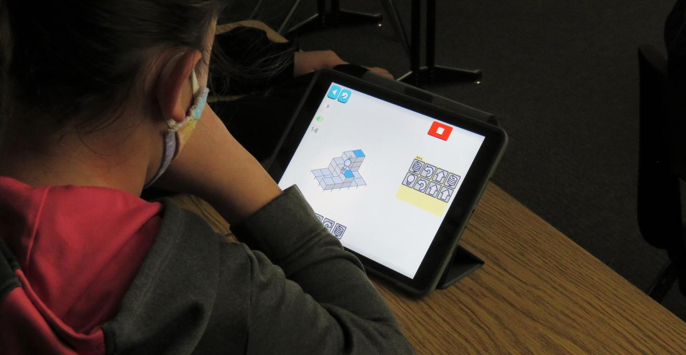 Page students practice coding.