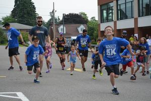 Children participating in the OLSH Rally for McNally Kids Fun Run start the race