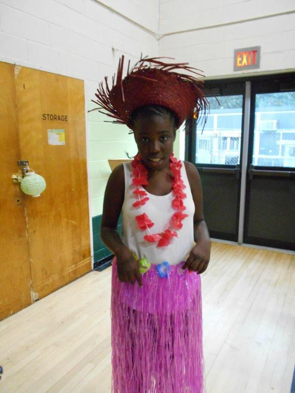 Student in luau outfit