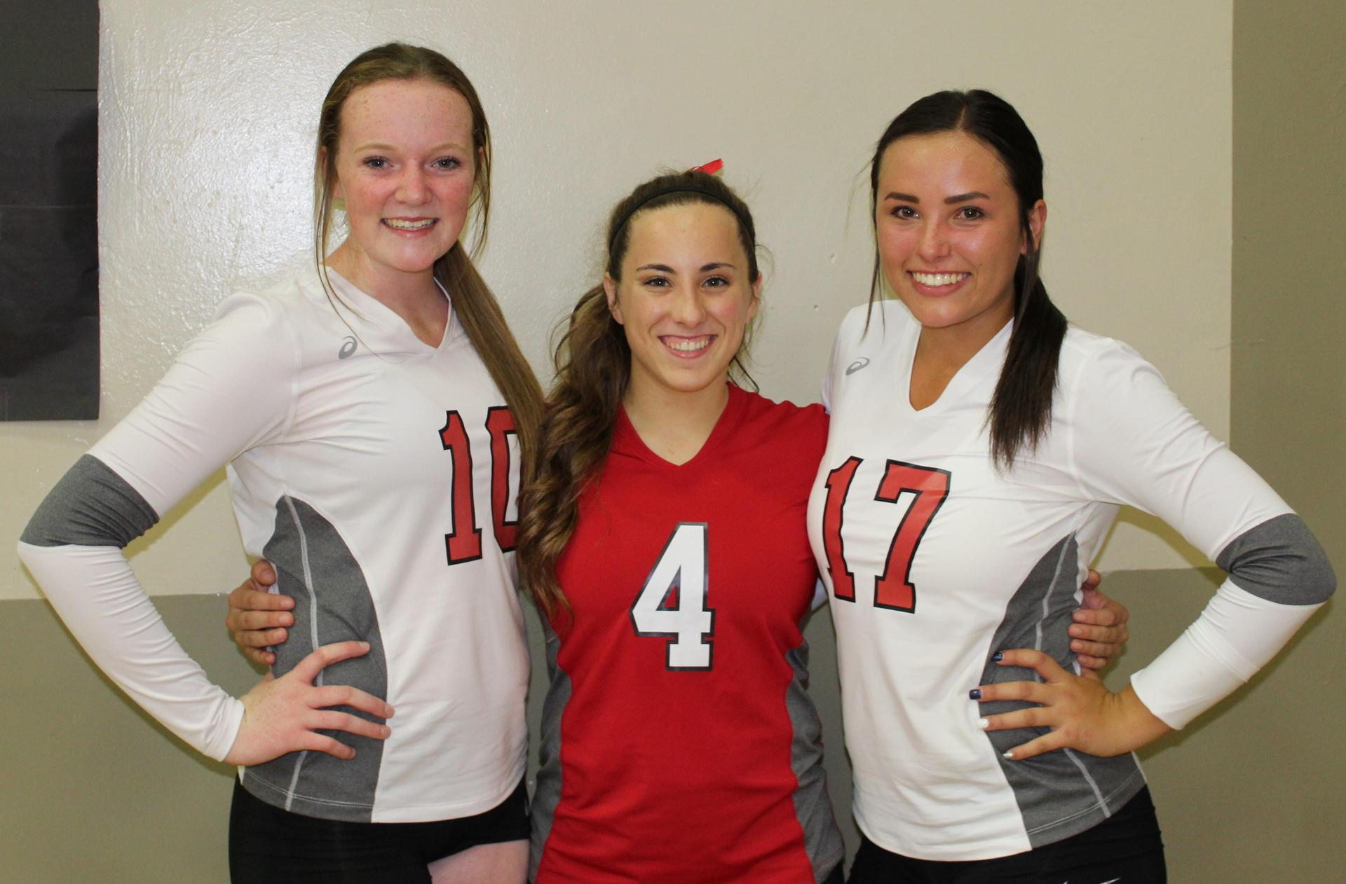 Tori Calley, Hannah Mancebo and Sydney Alexander pose on Volleyball Senior Night.