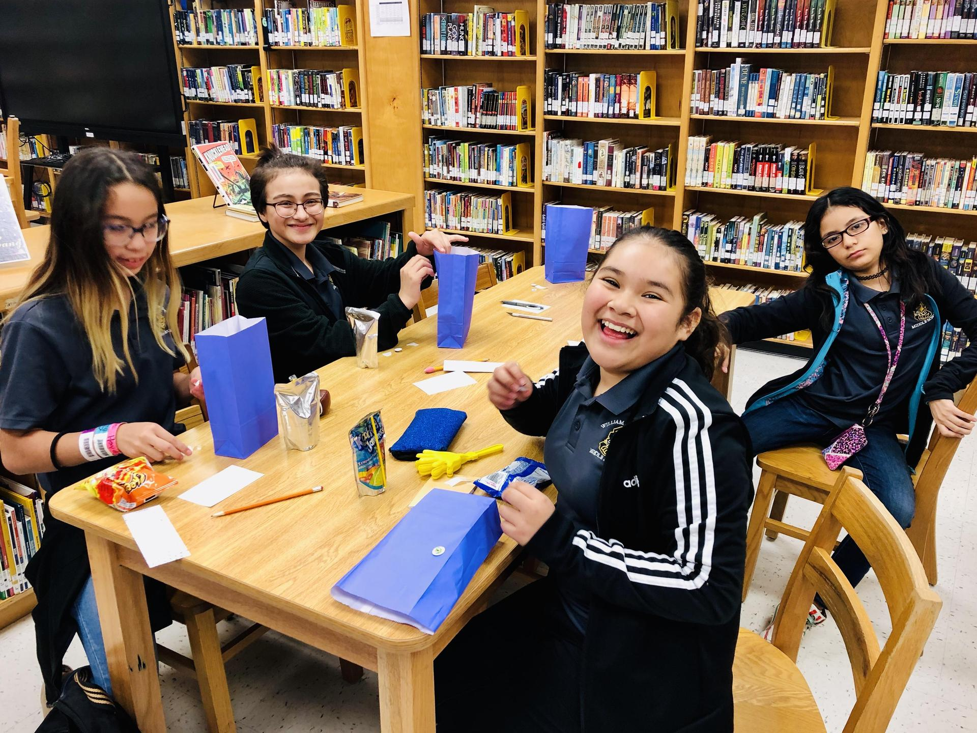 Students pose in the library.