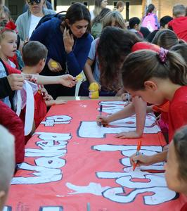 Jefferson students sign banner on Walk to School Day.