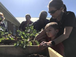 West Lauderdale students planting in the salad table that was donated to them by East Mississippi Master Gardeners.
