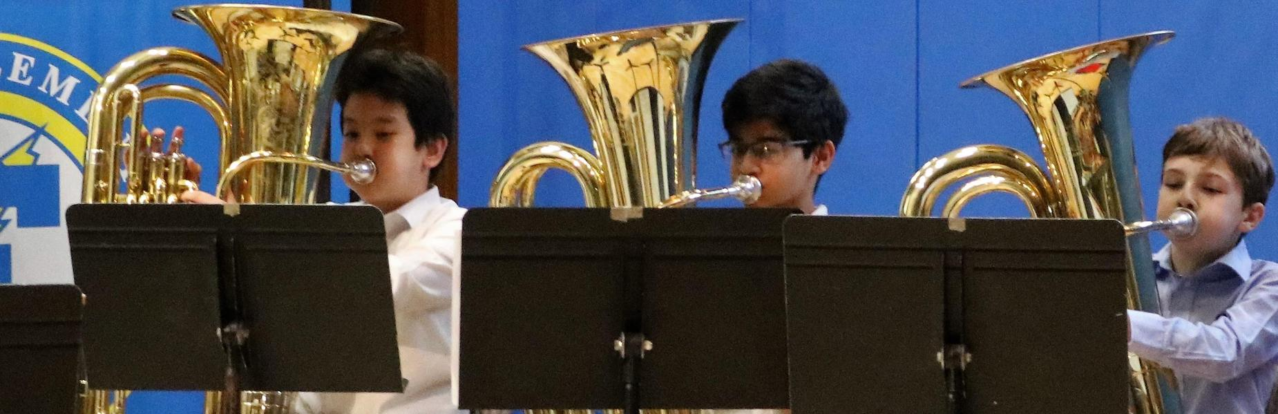 Photo of three Franklin 5th grade tuba players during winter concert