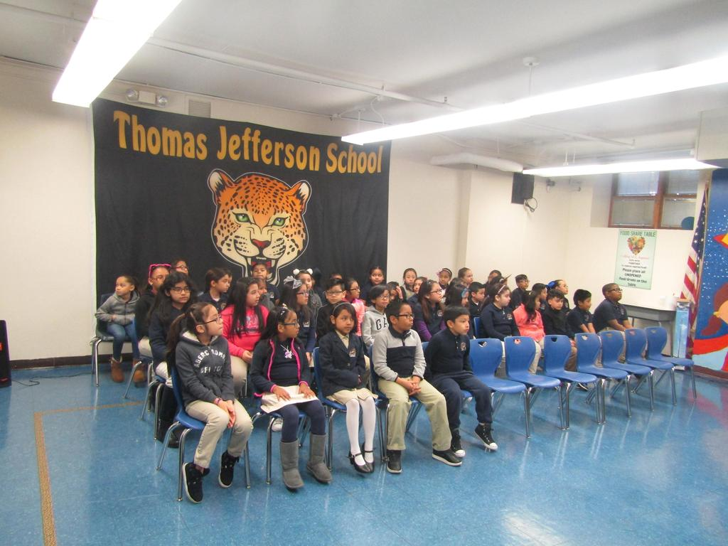 most of the honor roll recipients sitting and waiting to start