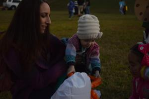 A mom a baby attended fall festival.