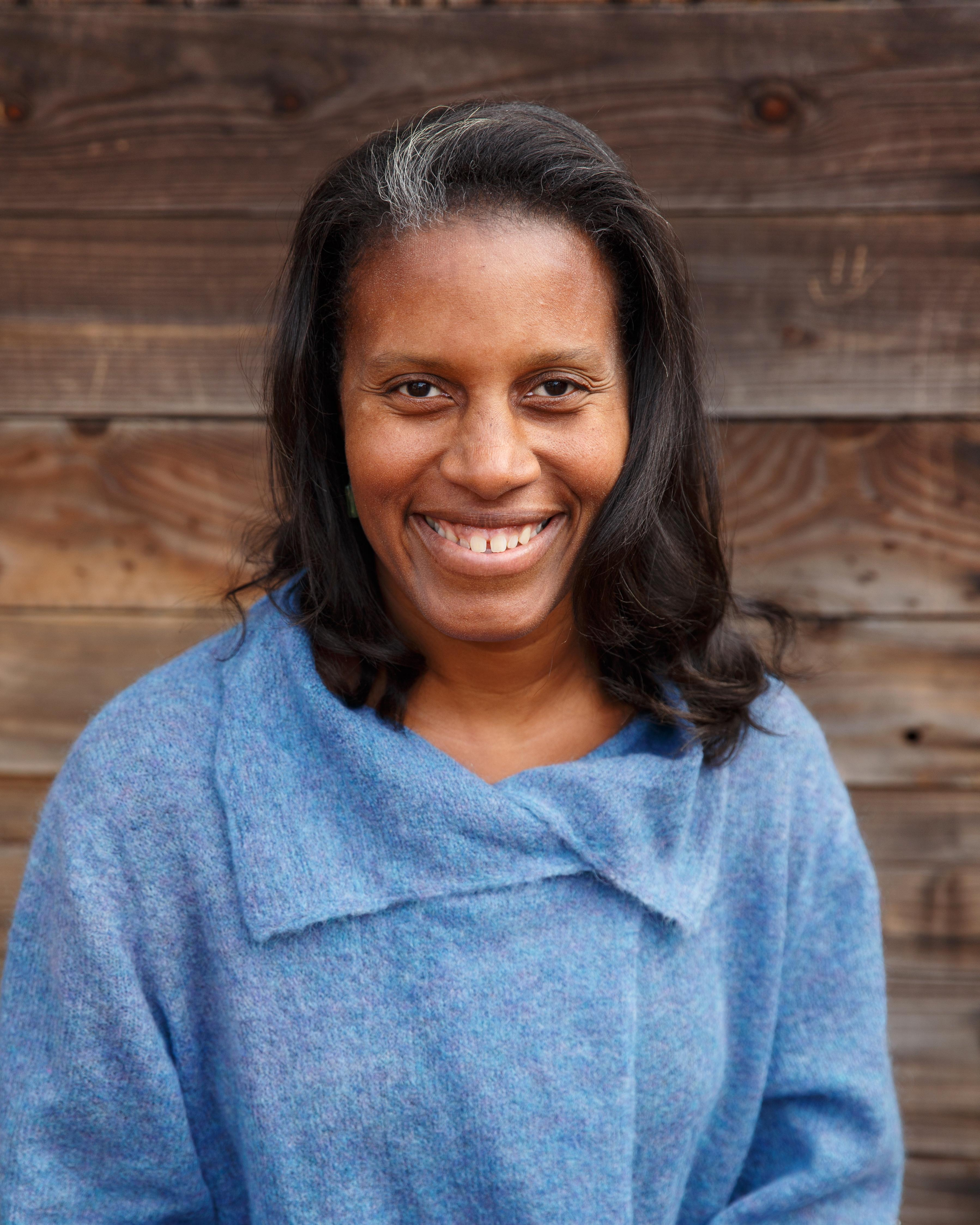 Photo of a smiling Black woman. Caption reads Kemmeo Parr, Director of Admission