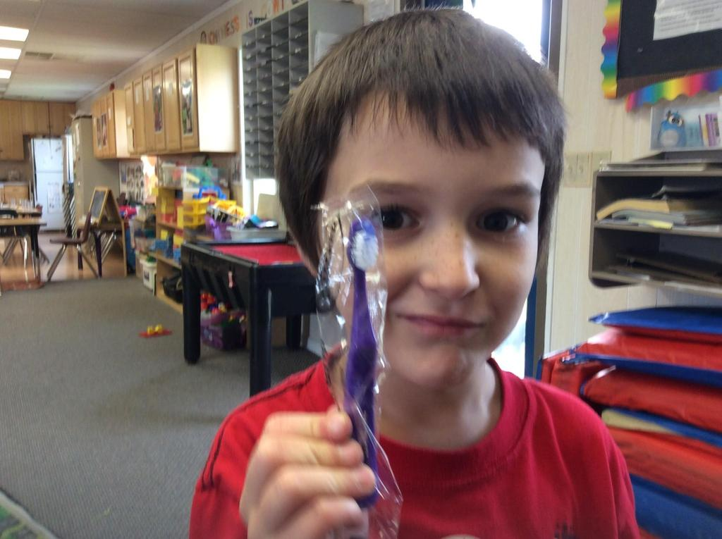 a boy with a tooth brush