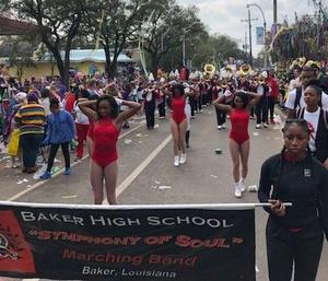 a photo of The Baker High School Symphony of Soul in the Krewe of Tucks parade coming down historic St. Charles Ave.
