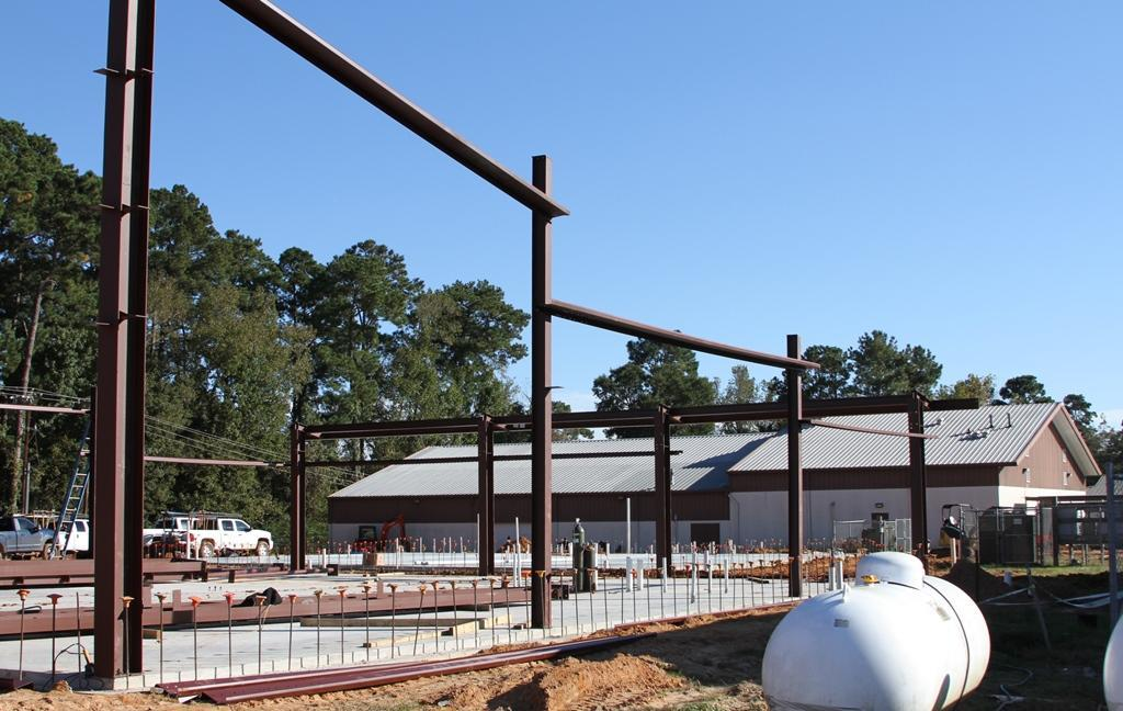 Building beams going up on foundations