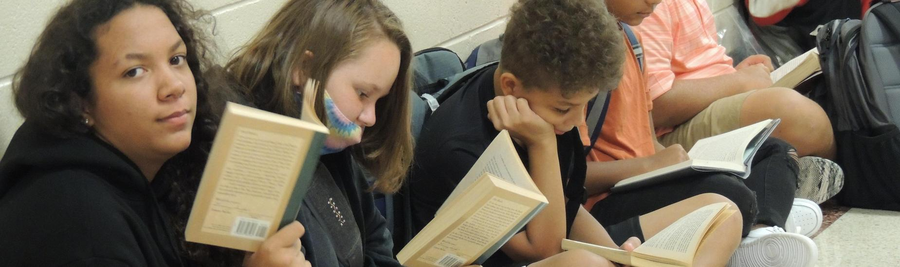 Students reading in the hallway