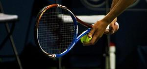 closeup photo of tennis racket