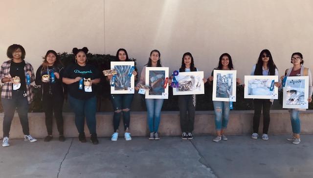 CSHS Winners Holding their Art Work