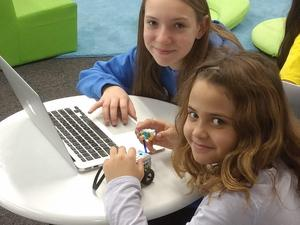 Students use code to program a robot