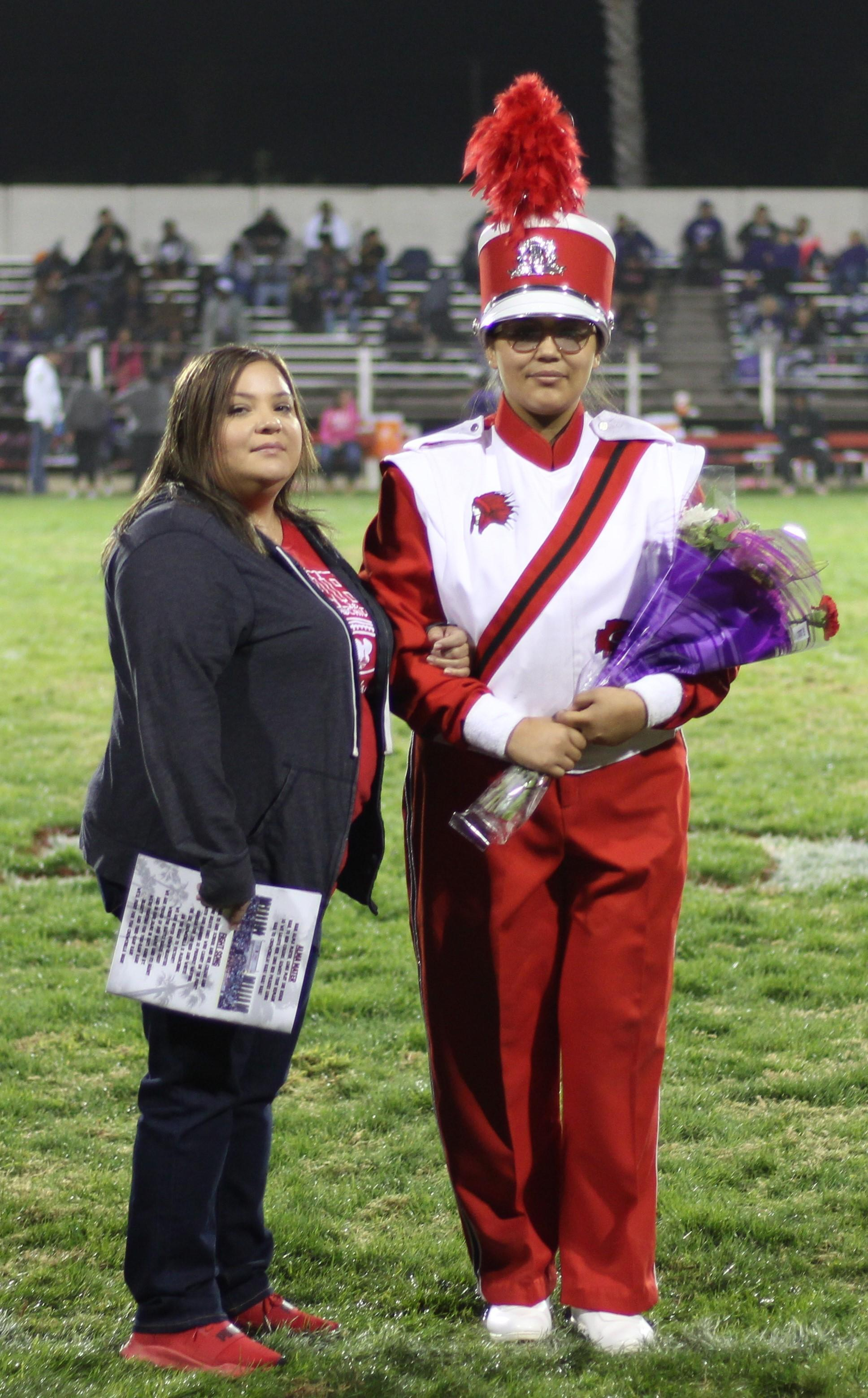 Senior band member Jessalyn Guardado and her escort.