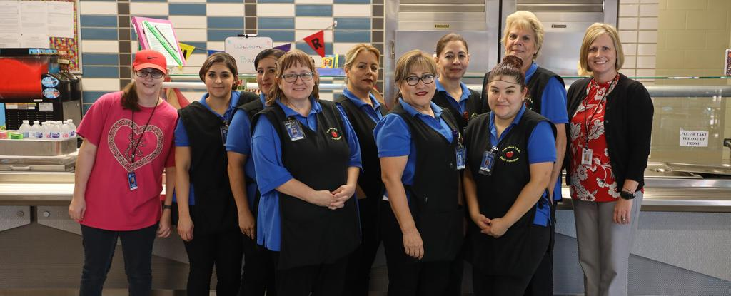 cafeteria workers pose for picture