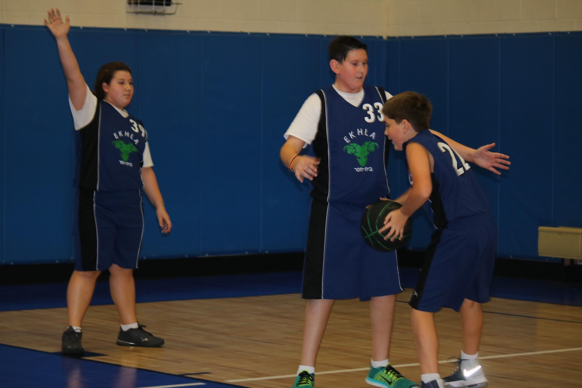 boys blocking shot playing basketball