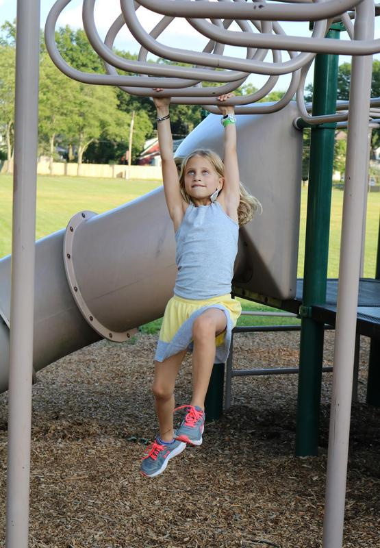 Jefferson School student enjoys playground during Summer Social.