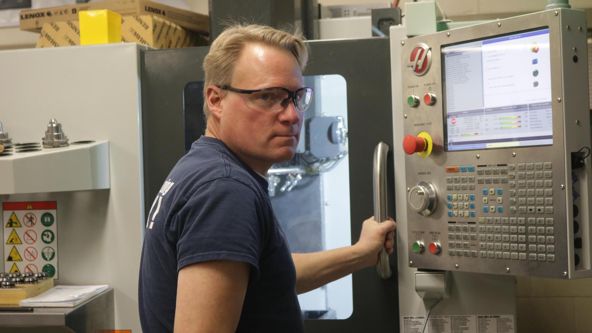 Mr. Burgher in machine shop