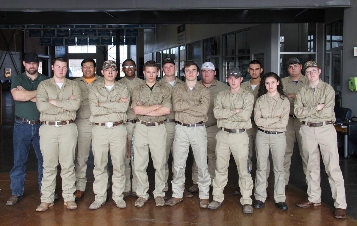 group of welding students in uniforms