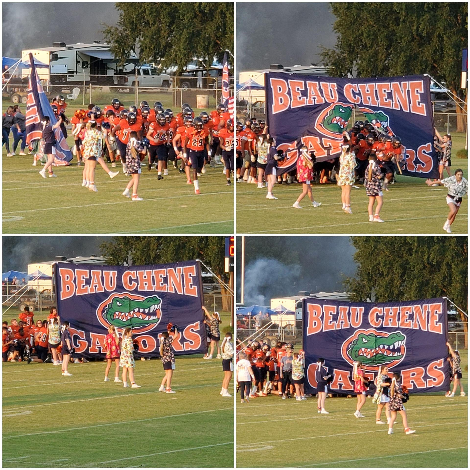 Cheerleaders hold banner for the Football Players
