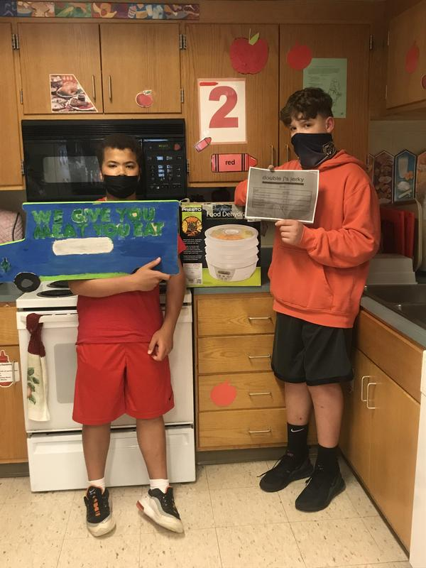Students with their food truck design