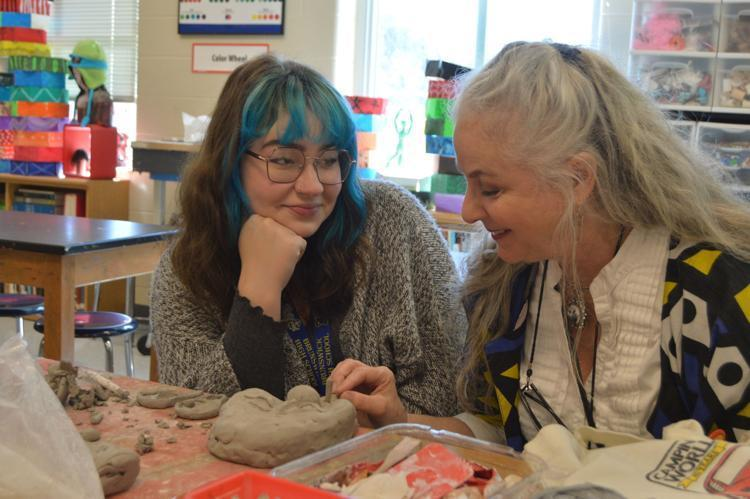 Tamara Daughtry, right, speaks with an art student during her class planning period. Daughtry's years of experience using the online art education platform Artsonia has been especially beneficial this school year.