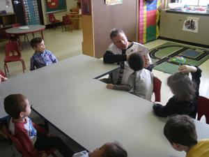 Hi-Toms coach works with students.