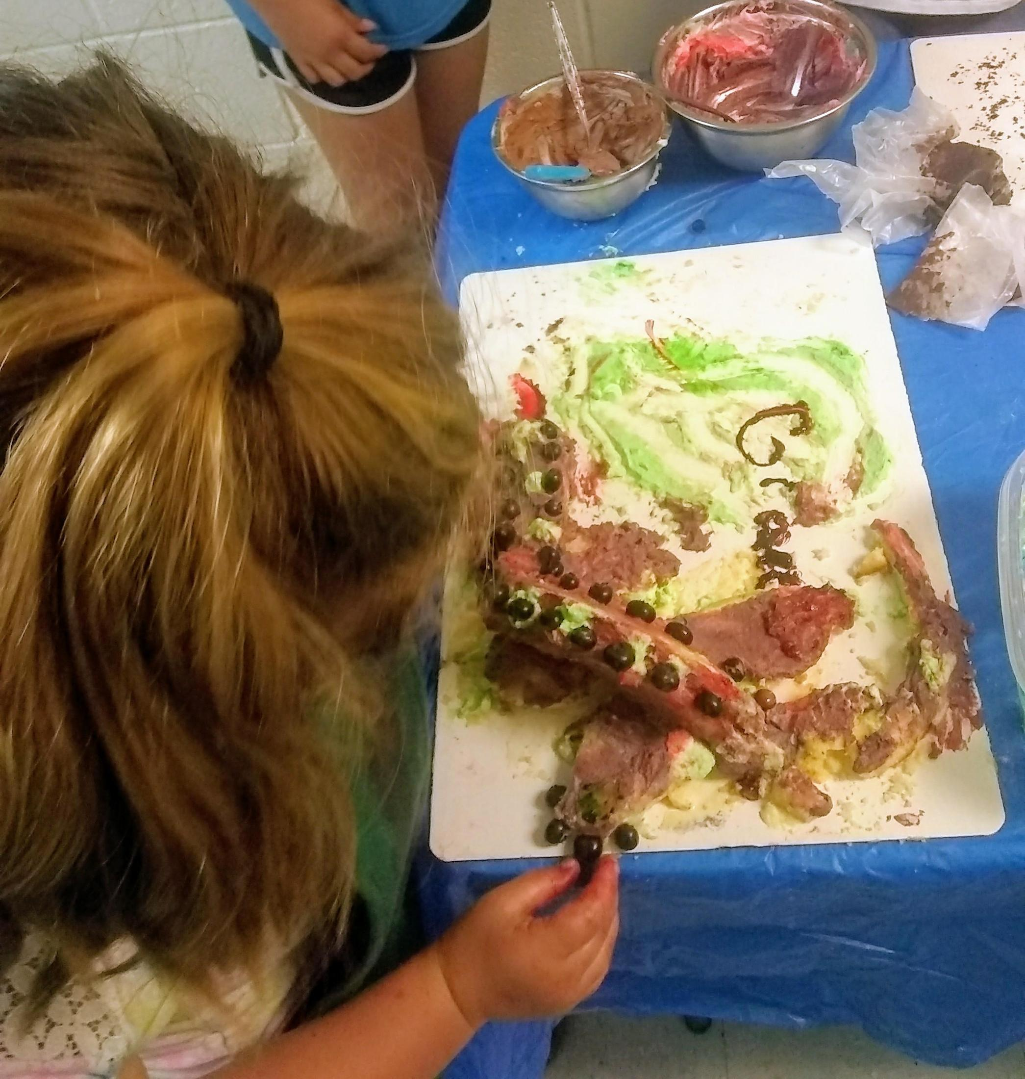 kids decorating cakes in animal shapes