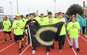 Students in Burleson Friends Festival Parade of Champions