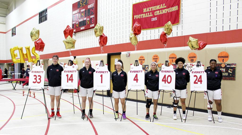 EHS seniors stand next to displays featuring their jersey numbers