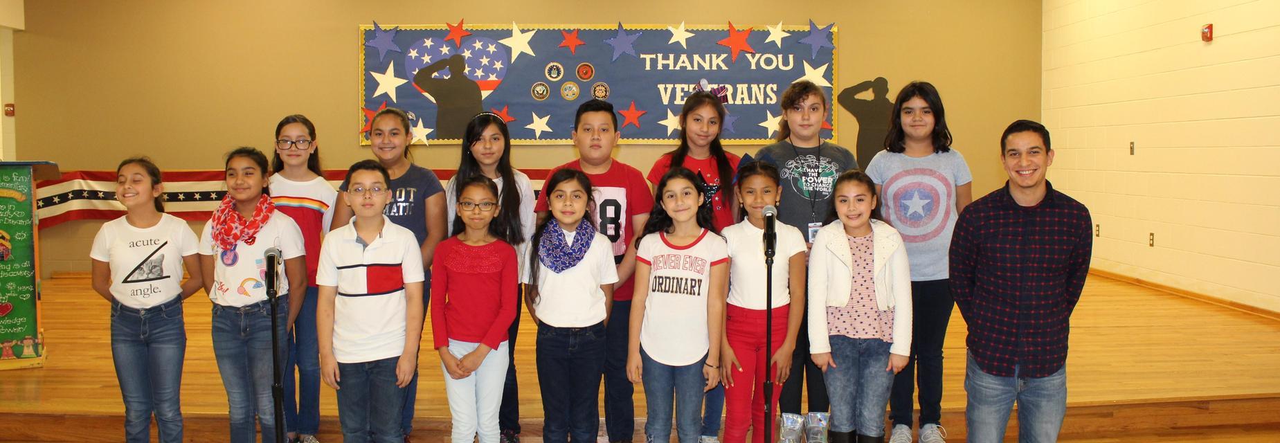 Mr. Gonzalez, music teacher, and the choir kids