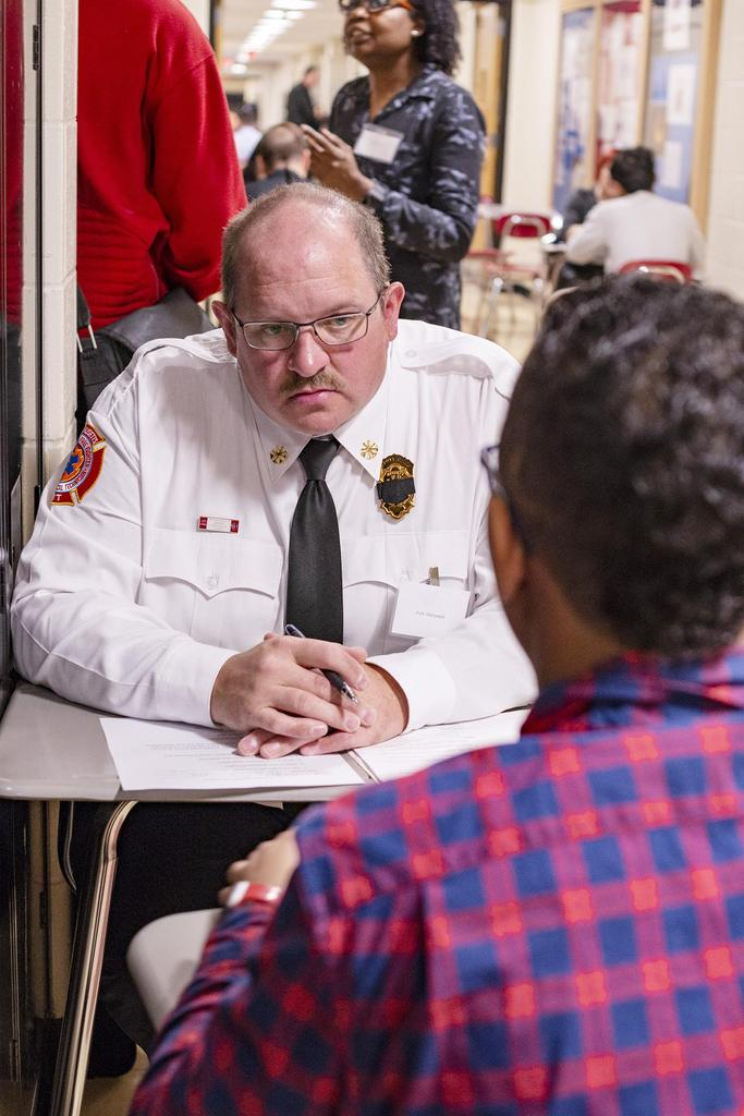 A close-up of Everett Fire Deputy Chief Scott Dalrymple as he interviews a student