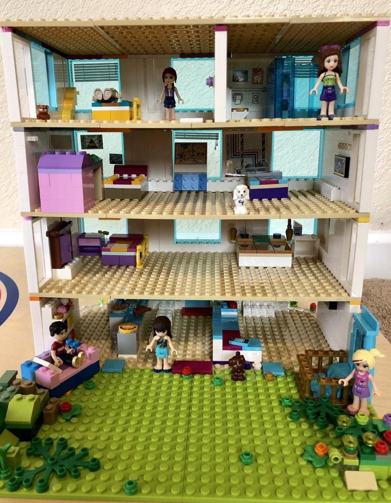 picture of multistory lego house with lego people in rooms