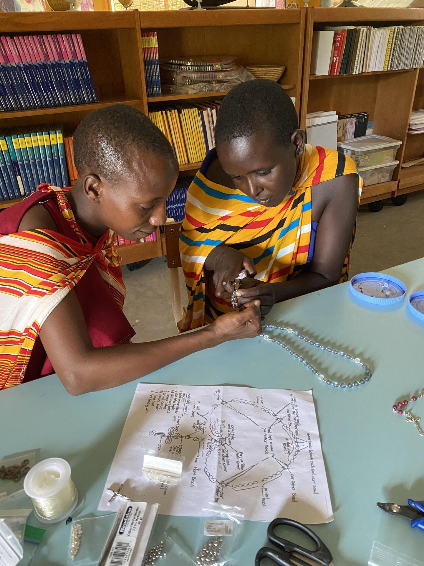 Two Maasai Women Making Rosaries