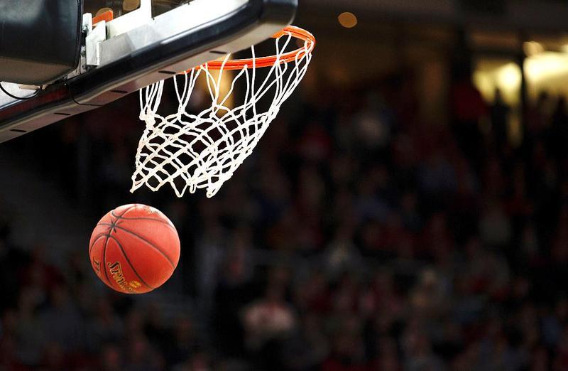 Stock image, a basketball going through a net