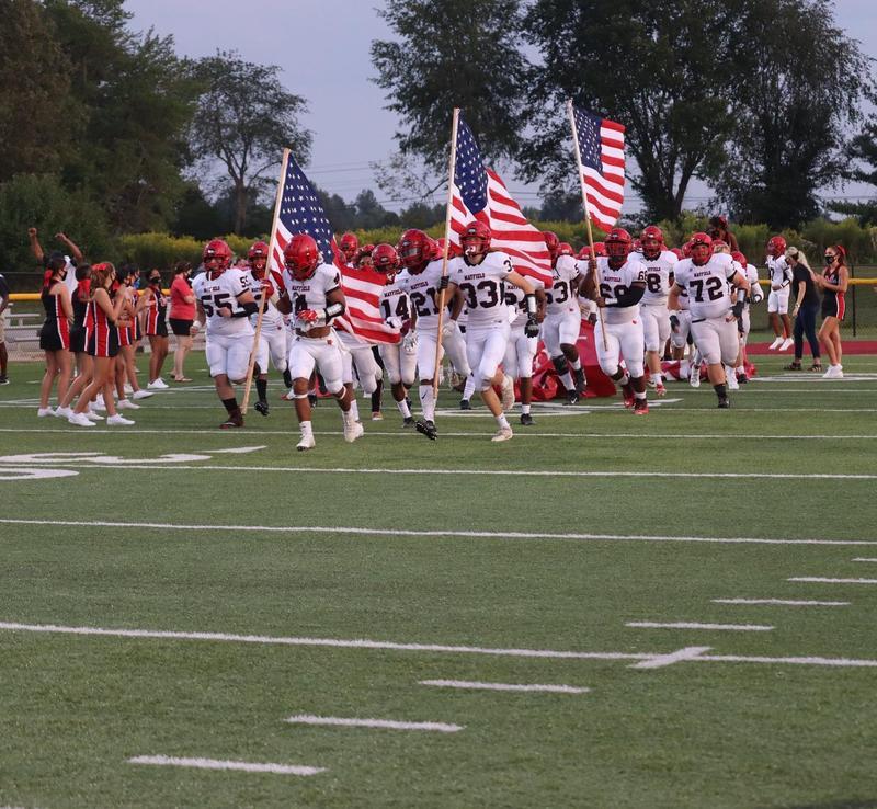 Football Team Running In
