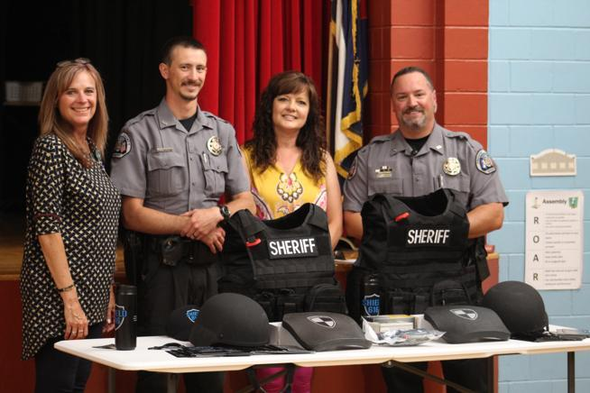 Principal Drenda Manning and Health Tech Kristi Hawver with Fremont County Sheriff Deputies.
