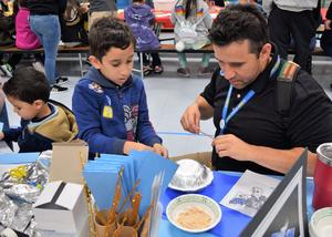 Foster Elementary School students and families use common household items to create and test science-themed devices during the school's fourth annual science, technology, engineering, arts and mathematics (STEAM) night on Jan. 31.