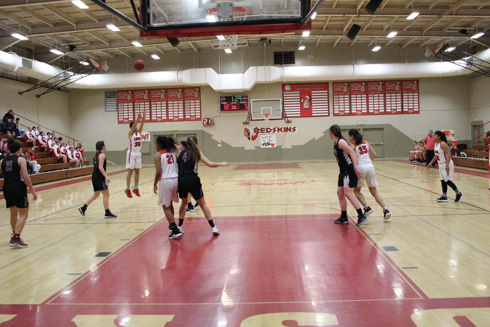 Varsity girls basketball playing Fresno Christian